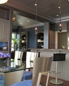 The entire kitchen was sprayed with Modern Masters Mtallic Paint. The walls are Pewter and Silver was used on the trim and ceilings. Project by Tobey Renee Sanders of FauxDecor.