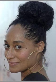 Curly high bun. Love her hair, style, and beauty. Tracee Ellis Ross's natural hair.