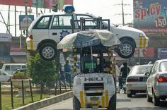Fuuny Cars in Pakistan   Traffic Police Car Lifter lifts Police's Car