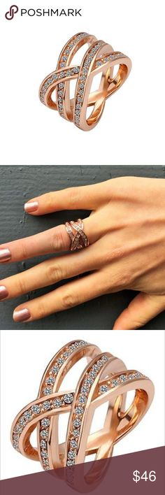 """Cate and Chloe Ring NWT Cate and Chloe Victorious Ring...elegance meets fearlessness. Embrace your tenacious spirit with the Nicole """"Victorious"""" Ring! Uniquely designed with 3 criss-crossed Rose Gold bands magnificently lined with CZ stones, this ring is sure to make a statement! Product Specifications: Rose Gold Plated with CZ Stone embellishments. Size 6 Best suited for index, middle, or ring finger. Retail $99 Cate and Chloe Jewelry Rings"""