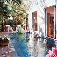 This narrow lap pool is built right up close to the home's back doors to accomodate the small backyard space.