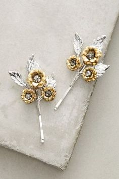Anthropologie Gilded Garden Bobby Pin Set https://www.anthropologie.com/shop/gilded-garden-bobby-pin-set?cm_mmc=userselection-_-product-_-share-_-41726514