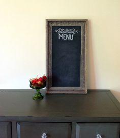 Sign- framed chalk board (chalk board paint on cardboard?)