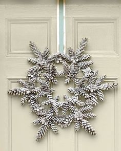 This winter white wreath is the perfect decoration to greet guests with a warm, holiday welcome.