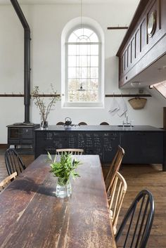 church / home / conversion / dining / table / mismatched / kitchen / window / fire / fireplace /