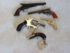 Group of 5 miniature Vintage Toy Hand Guns by cottagetocastle. $35.00, via Etsy.
