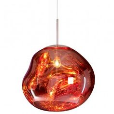 The Melt range of lights by Tom Dixon is a series of asymmetrical, distorted spherical pendant lights with a bright glow.