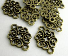 30Pcs 12x19mm Antique Bronze BrassFloral Links Base Metal Findings Antique Links Metal Charms  (6330). $2.45, via Etsy.