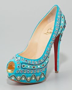 Christian Louboutin Bollywoody pump really captures the Traditional Indian spirit with traditional colors... Would take some effort to create the right outfit but beautiful and really original $2795