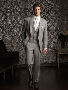 I want my groom to wear a grey suit, I think. It depends on what he likes :)