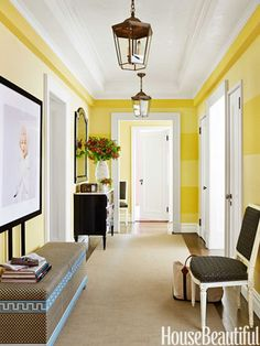 Wide yellow stripes and Milton Greene's portrait of Marilyn Monroe bring a touch of playfulness to the front hall.
