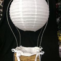 My husband proposed in a hot air balloon so that was our wedding theme. I made this hot air balloon for the cards at the reception. Just used a Chinese lantern, coat hangers and a basket! It was a hit!