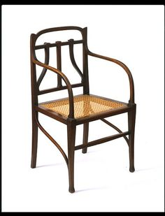 Chair / c. 1902 / Italy / Ernesto Basile / carved and joined stained wood with caned seat