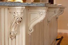 carved kitchen island corbels