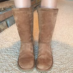 Chestnut ugg boots Stiffer than classic tall ugg boots. Zipper on the inside. Dark mark on the back tops from jeans. Only worn 3 times...in great condition! UGG Shoes Winter & Rain Boots