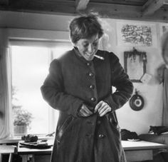 tove jansson. long dark coat. short messy hair.