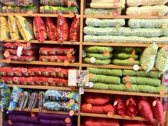A bright and colorful wall of Pier 1 Outdoor Cushions