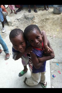 HAITI = Walking along the street they would grab your hand & walk with you for a ways. Very precious