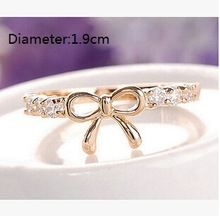 Our dainty little FAE Ribbon Stackable Ring features faux crystals on a traditional gold ribbon setting. Jewelry Supplies, Jewelry Stores, Gold Ribbons, Affordable Jewelry, Stackable Rings, Promise Rings, Wholesale Jewelry, Korean Fashion, Gold Rings