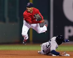 Boston Red Sox second baseman Mookie Betts watches his throw to first after forcing out New York Yankees' Antoan Richardson on a double play hit into by Jose Pirela during the ninth inning of a baseball game at Fenway Park in Boston, Friday, Sept. 26, 2014. (AP Photo/Charles Krupa)