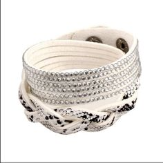 """HOST PICKFaux Leather Wrap Bracelet white Faux snakeskin print on braided section. Subtle bling embellished other half. Bracelet is one continuous piece that is meant to wrap around the wrist and snap together. Approximate total length, 15 1/2"""". Not genuine leather. Not for large wrists. Brand new and unworn. No trades, no holding, no offsite payment.         All $12 jewelry is two for $20      PRICES ARE FIRM UNLESS BUNDLED Jewelry Bracelets"""