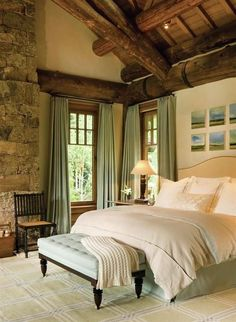 Love this bedroom! Wood ceiling, stone fireplace, green color scheme