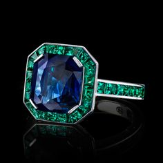 A vivid blue sapphire is surrounded by an architectural border of perfectly matched emeralds set in white gold. Robert Procop