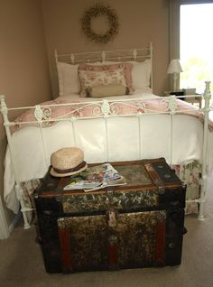 antique trunk & iron bed.