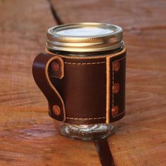 Canning jars make wonderful drinking receptacles - and exude a quaint country charm that begs for a second glass of ice-cold lemonade (maybe with a little kick, if you catch my drift). How else could this simple vessel be improved? With this awesome handled jar koozie, duh.