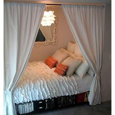 bed in a closet...the whole room is open!  and it looks so cozy.  :)
