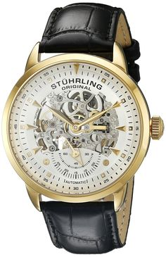 Stuhrling Men's 133.33352 Symphony Automatic Gold-Plated Black Leather Strap Watch. Round watch with silver skeleton dial featuring gold tone hands, markers, and small seconds subdial at 6 o'clock. 44mm stainless steel 23K gold tone round case with shatter resistant Krysterna crystal dial window. Water resistant to 50 meters (165 feet). Black genuine leather strap with crock texture and buckle closure. Automatic Movement with analog display- This watch is powered by the motion of the...
