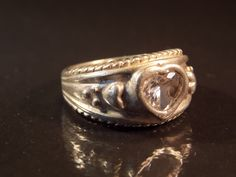 Sterling Silver Ring with Heart Band & CZ Heart -  Size 4.75-5.0 - 6.6 grams. $22.99, via Etsy.