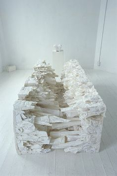 "The Japanese artist Naoko Yoshimoto presents ""White coffin"", a collection of sculptures made of linen, which constitute real blocks of textile art."