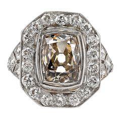 Cushion Cut Diamond Platinum Statement Ring. 2.50 carat cushion cut diamond set in a platinum mounting. Circa 1920.