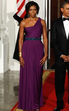 DOO-RI CHUNG Mrs. O. stole the show in her mesmerizing purple ruched gown at a state dinner for the South Korean president. A bold statement gold cuff, chandelier earrings and dazzling beaded belt added oomph to her look.
