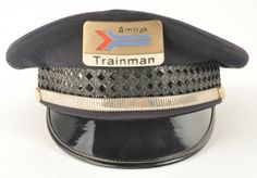 Railroad Trainman's Cap from Amtrak with enameled cap badge and Amtrak marked buttons on either side of flexible metal band. No manufacturer's mark inside. size: unmarked