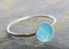This dainty turquoise blue enamel ring is handmade from sterling silver in my . The front of the ring measures 5mm across.  The beautiful