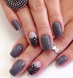 Gray, nude and black polish winter nail art design. Give a wonderful accent on your gray themed nails by painting details of lace designs and flowers using the black nail polish.