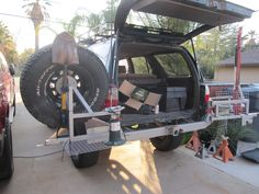 Rear swing out tire carrier pics? - Expedition Portal