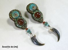 Bead embroidered earrings, featuring carnelian cabochons, turquoise beads, carnelian beads and coyote claws.