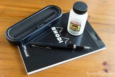 Fountain Pen Newbie Package Set includes everything you need to get started - a Pilot Metropolitan fountain pen, bottle of Noodler's Black ink, and a Rhodia notepad.