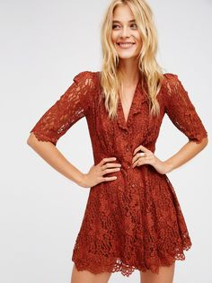 Lace Mini | A true vintage look, this darling lace dress features a modest shape with front button closures and sheer quarter length sleeves. Super stretchy lining.