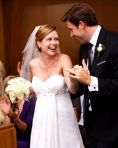 The Office's Pam Beesly  Fans of The Office waited five long seasons for Pam Beesly (Jenna Fischer) and Jim Halpert (John Krasinski) to tie the knot. For the couple's 2009 Niagara Falls wedding, Pam chose an empire-waisted gown (the perfect choice to accommodate her baby bump) from David's Bridal.