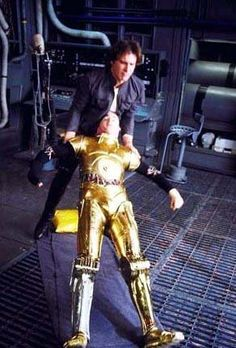 Harrison Ford helping Anthony Daniels stand up after a break during filming of Star Wars The Empire Strikes Back.