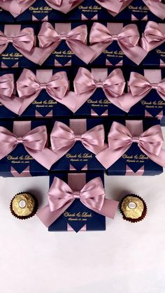 Navy blue & gold personalized wedding favor box with dusty rose satin ribbon bow and custom names, Elegant gift boxes make a unique way to thank guests for attending your special day. #welcomebox #giftbox #personalizedgifts #weddingfavor #weddingbox #weddingfavorideas #bonbonniere #weddingparty #sweetlove #favorboxes #candybox #elegantwedding #partyfavor #bluewedding #giftboxes #navybluewedding #goldwedding #uniqueweddingfavors #uniqueweddingideas #dustyrosewedding