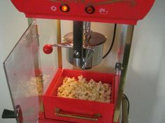 Popcorn popper reviews! Great family gift idea. Choose from bestselling customer favorites ranging from hot air poppers, microwave poppers, to this popcorn cart that sets in the corner of my kitchen! (You can't have mine, but I'll show you where you can buy your own!)