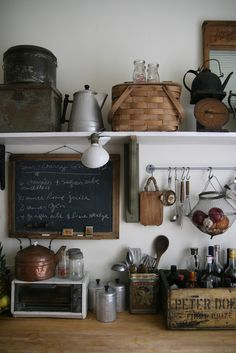 .~~~~The baskets and wood and white here are just fabulous. All the textures add so much interest to this area~~~