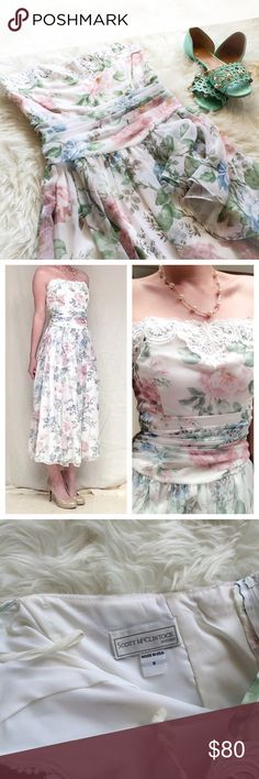 """Vintage floral spring midi dress medium 6 8 Gorgeous vintage midi length dress. Size 8, but I'm typically a 6 and it fits great. Measurements are laying flat chest- 16.5"""", waist-13.5"""",  length-43"""" no rips or stains, bought from a vintage boutique for and only worn once for a special even for about 5 hours. One of the rare vintage dresses that has stood the test of time  Vintage Dresses Midi"""