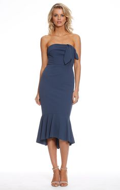 Dollface Strapless Midi. A beautiful midi length dress by Pasduchas. A strapless style featuring a draped faux tie detail in the bodice and frill hemline.