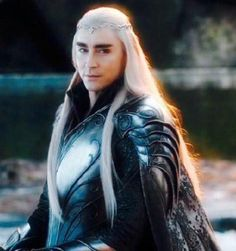Men fought alongside Elves in the War of the Last Alliance -- So Thranduil has no quarrel with Bard and accompanies him as he offers the Arkenstone to Thorin in exchange for his people's fair share of the Erebor treasures.